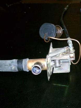 The complete heater valve unit with the cable, sleeve and a water hose attached
