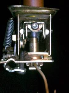 The internal mechanism with the gray plunger of the safety mechanism extending from its brass tube. The Torx adjustment screw is at the top center, just above the plunger, in this picture